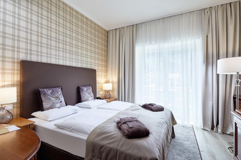 Фото Das Alpenhaus Hotel (ex. Grand Park Hotel) Бад Хофгастайн