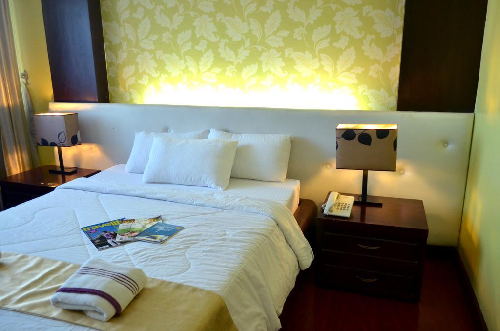 Фото San Remigio Pensionne Suites Филиппины о. Себу