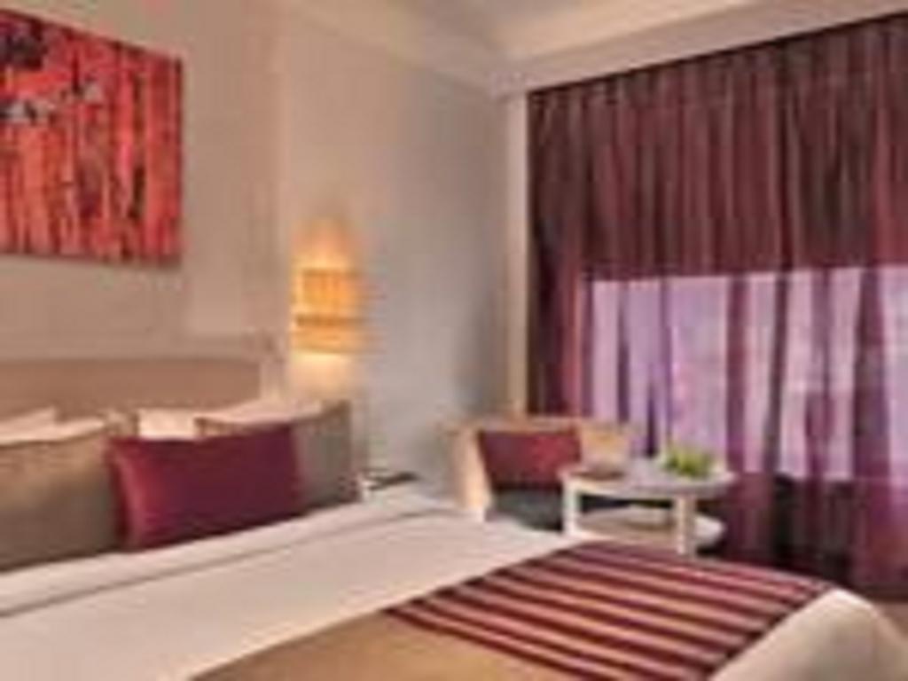 Отель The Ashtan Sarovar Portico Дели