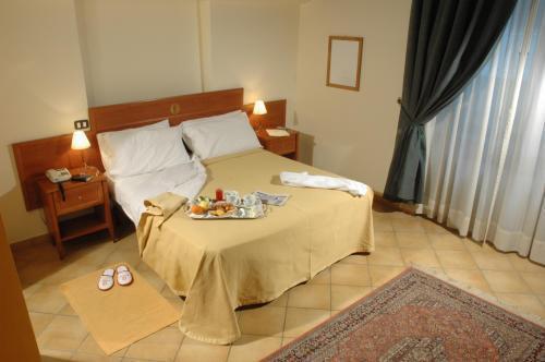Фото Caravaggio Hotel Неаполь