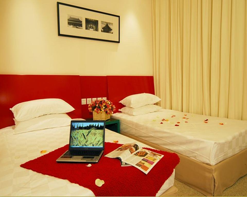 Отель Traveler Inn Huaqiao Beijing Пекин