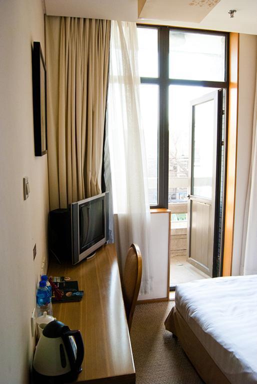 Фото Traveler Inn Huaqiao Beijing Пекин