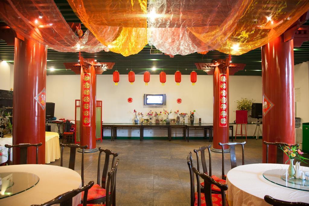 Фото Traveler Inn Huaqiao Beijing