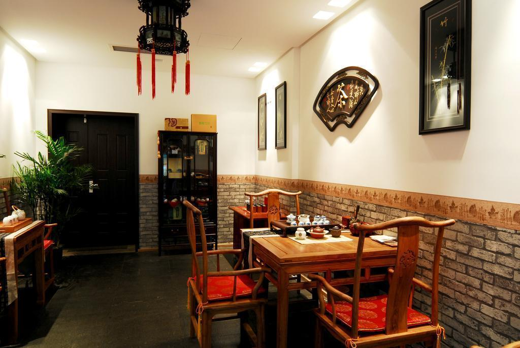Фото Traveler Inn Huaqiao Beijing Китай