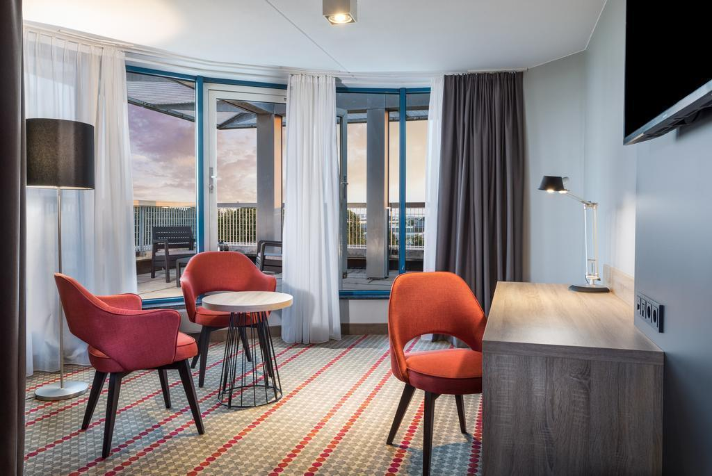 Фото Dorint Airport Hotel Amsterdam Нидерланды
