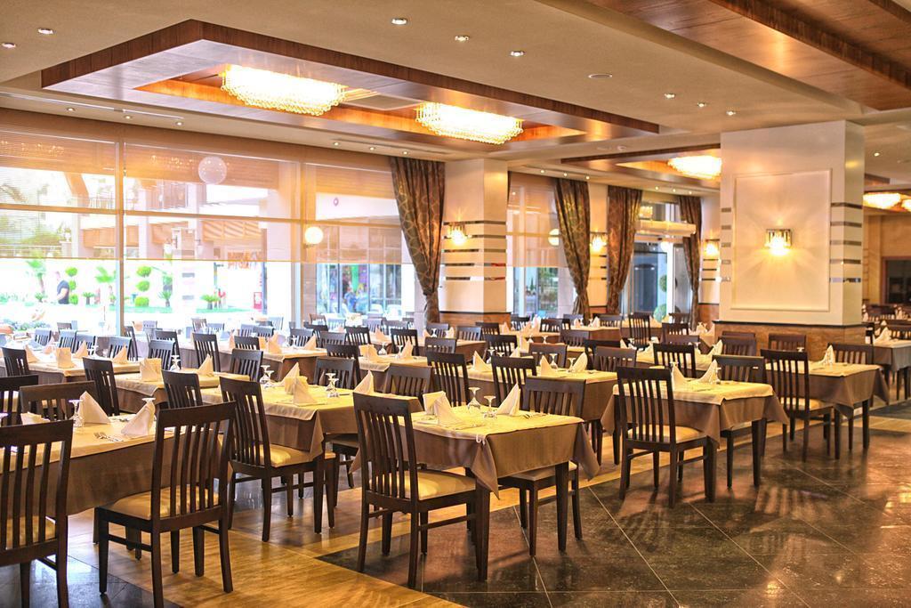 Фото Dizalya Palm Garden Hotel Турция Конакли